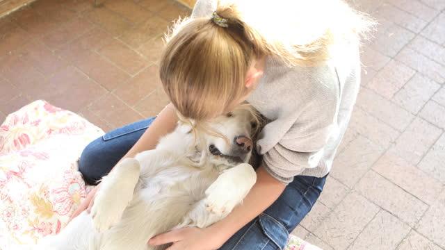 teenage girl embracing her retriever dog - only teenage girls stock videos & royalty-free footage