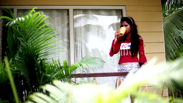 teenage girl enjoying early morning and having coffee break - coffee cup stock videos & royalty-free footage
