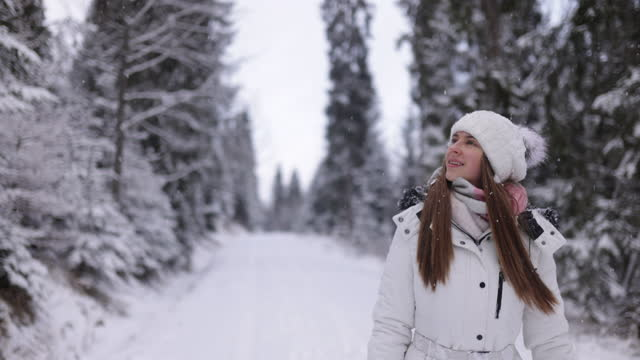 teenage girl enjoying hiking in winter forest - full length stock videos & royalty-free footage