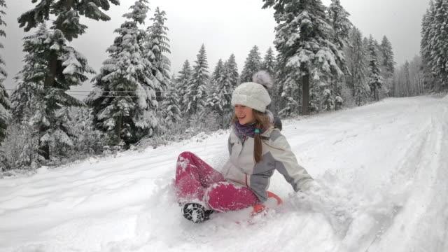 teenage girl enjoying sledding in winter forest. - imgorthand stock videos & royalty-free footage