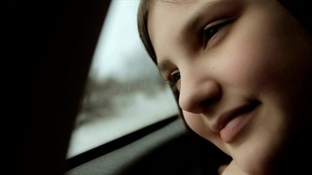 teenage girl enjoyment on the road,in the car, to the winter ski center - car interior stock videos & royalty-free footage
