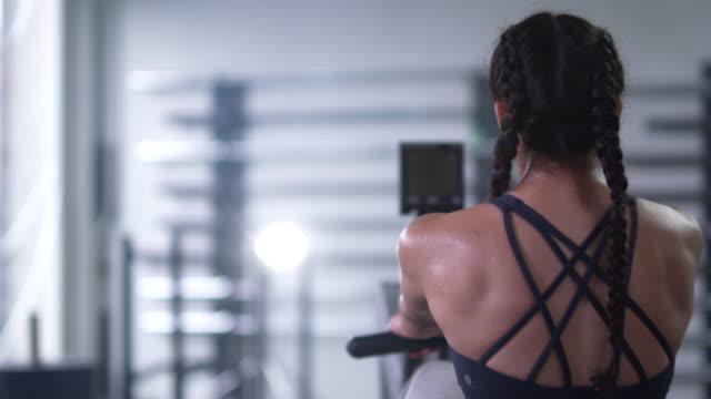 teenage girl exercising using rowing machine - rowing machine stock videos & royalty-free footage