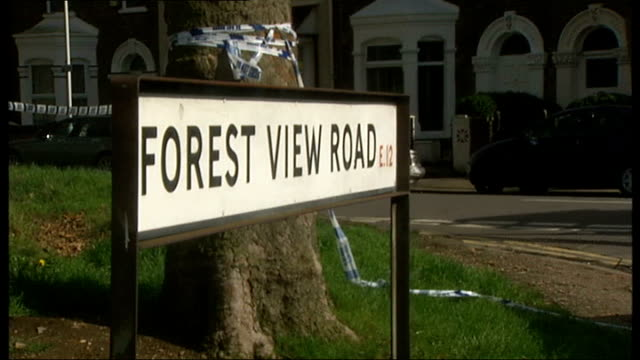 teenage girl found murdered in east london england east london manor park ext road sign for 'forest view road' police cordon tape around tree in... - itv london tonight weekend stock videos & royalty-free footage