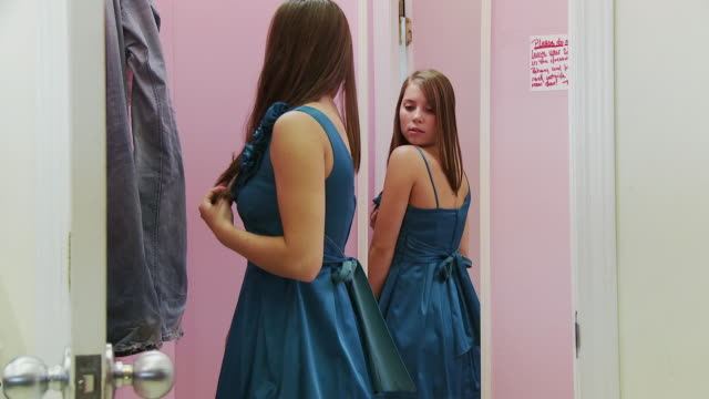 MS Teenage girl (16-17) getting dressed in fitting room / Morris, Illinois, USA