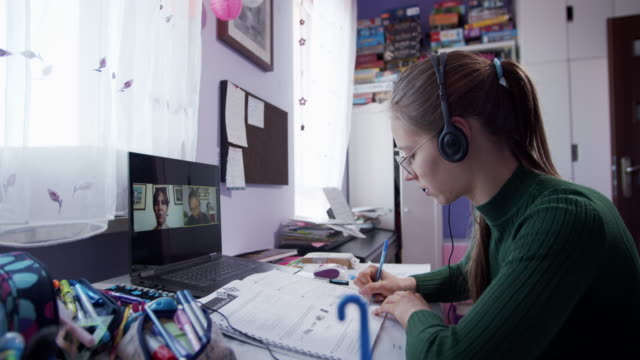 teenage girl having online lesson in her room. - studying stock videos & royalty-free footage