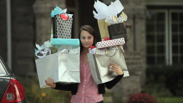 MS Teenage girl (16-17) holding pile of gifts / Neenah, Wisconsin, USA