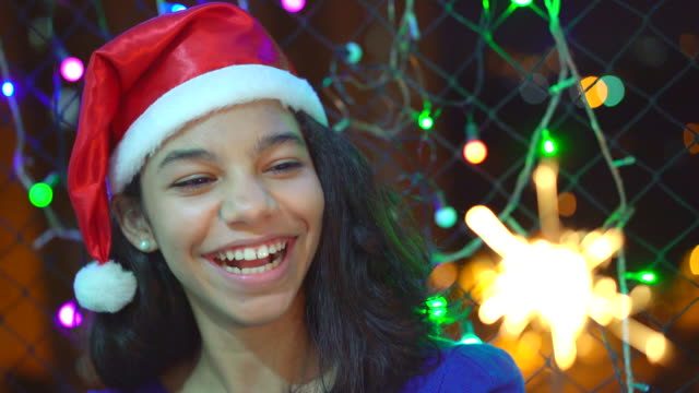 teenage girl holding sparkler light in the christmas night - light natural phenomenon stock videos & royalty-free footage