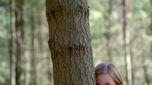 TD, CU, teenage girl hugging tree, portrait, USA, Pennsylvania, Solebury