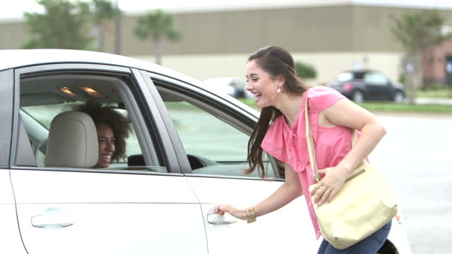 teenage girl in car picking up friend in new car - entering stock videos & royalty-free footage