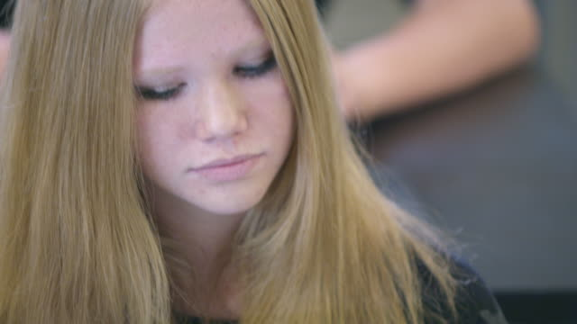teenage girl in class with a tablet. - one teenage girl only stock videos & royalty-free footage