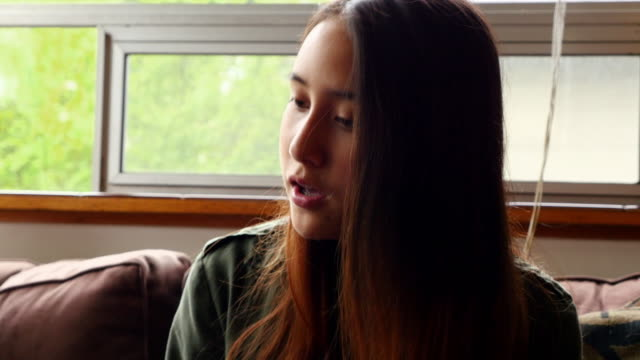 MS Teenage girl in discussion with sister in living room before school