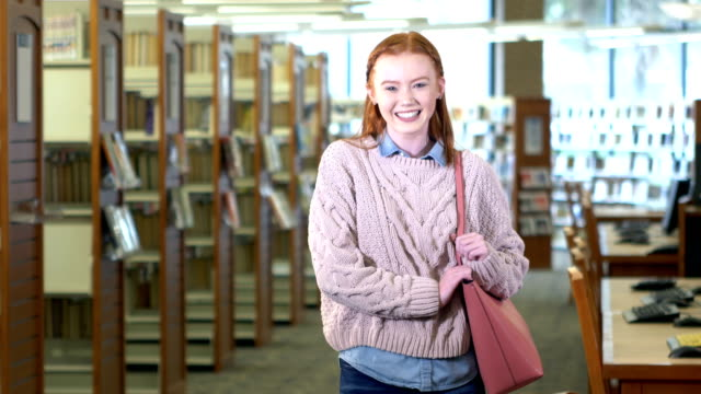 teenage girl in high school library - redhead stock videos & royalty-free footage