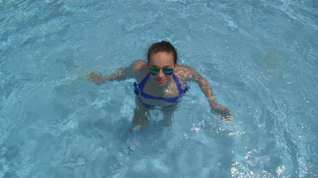 teenage girl in swimming pool - stepping stock videos & royalty-free footage