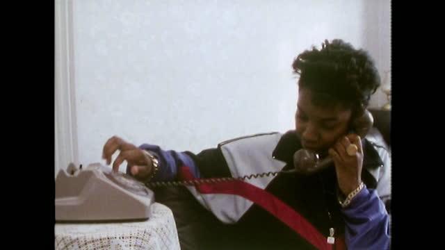 teenage girl in tracksuit dials rotary phone; 1989 - landline phone stock videos & royalty-free footage
