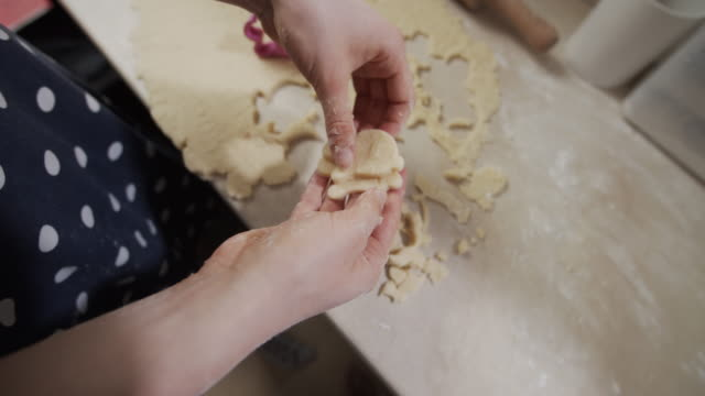 teenage girl is arranging cookies on buttered baking tray - baking tray stock videos & royalty-free footage
