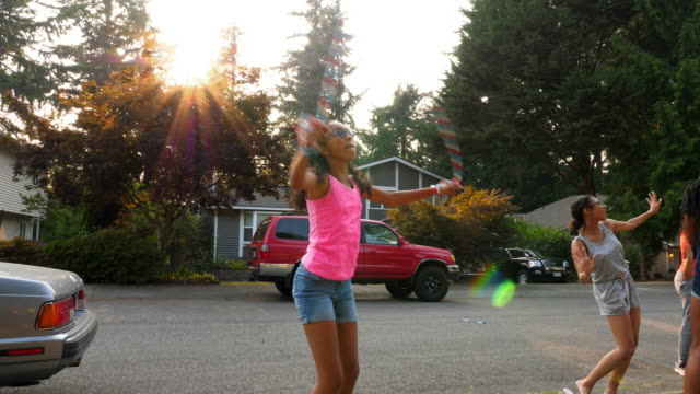 ms teenage girl jumping rope while hanging out with friends on summer afternoon - jump rope stock videos and b-roll footage