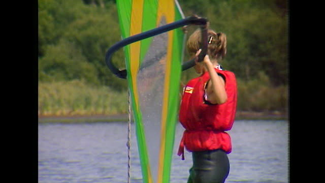 teenage girl learning to windsurf at summer camp; 1984 - life jacket stock videos & royalty-free footage