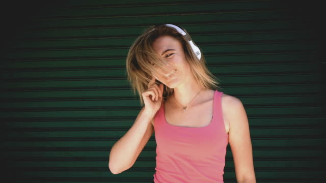 teenage girl listening to the music and tossing hair - shaking stock videos & royalty-free footage