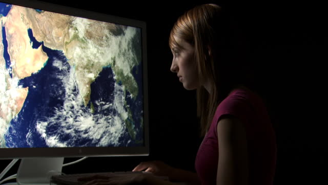 teenage girl looking at earth on computer monitor - see other clips from this shoot 1167 stock videos & royalty-free footage
