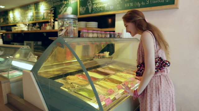 ws teenage girl looking at ice cream in a ice cream shop. - choice stock videos & royalty-free footage