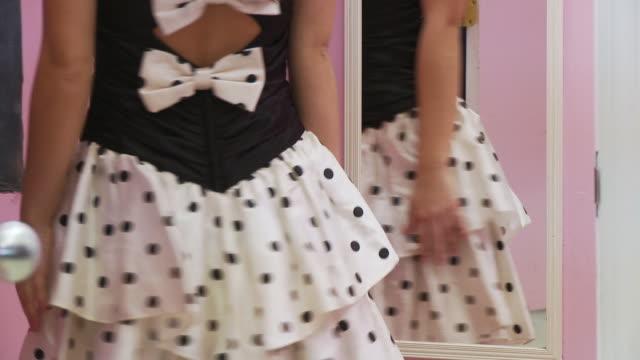 CU TU TD Teenage girl (16-17) looking at vintage dress in mirror / Morris, Illinois, USA