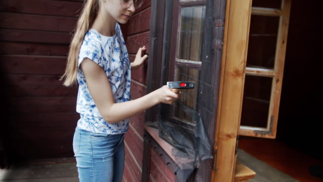 teenage girl making ad hoc mosquito net at home - netting stock videos & royalty-free footage