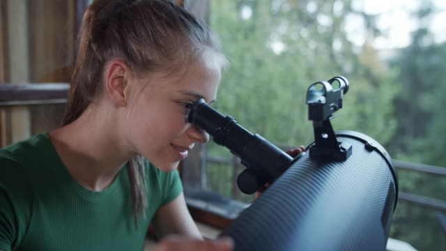 teenage girl observing nature using telescope - bird watching stock videos & royalty-free footage