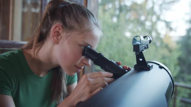 teenage girl observing nature using telescope - hobbies stock videos & royalty-free footage