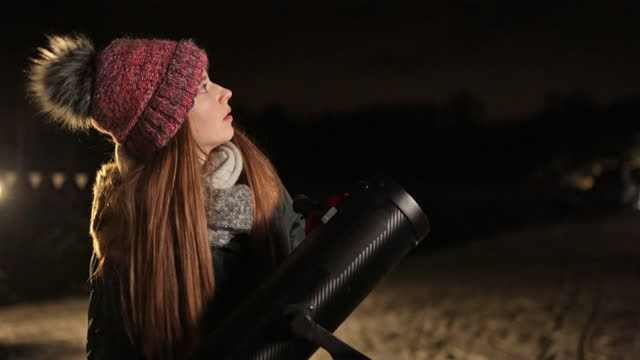 teenage girl observing the night sky with telescope - astronomy stock videos & royalty-free footage