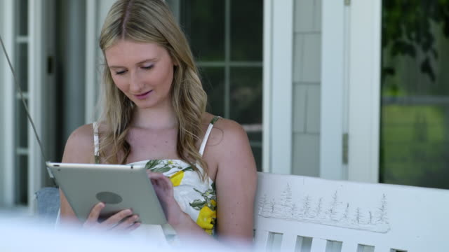 teenage girl on bench with tablet - 30 seconds or greater stock videos & royalty-free footage