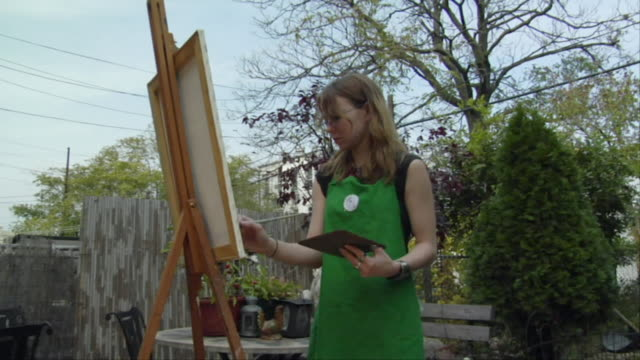 ms, zi, teenage girl (16-17) painting in garden, brooklyn, new york city, new york, usa - easel stock videos and b-roll footage