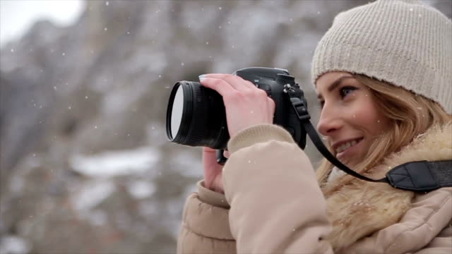 Teenage girl Photographing for memories from winter vacation