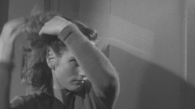 1947 ms teenage girl pinning hair up looking in a mirror / united kingdom - 1947 stock videos & royalty-free footage