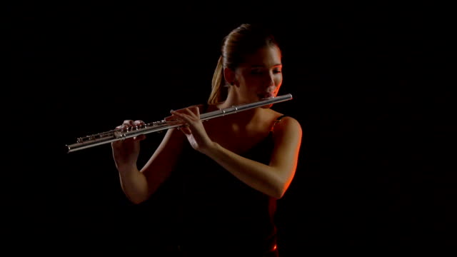 teenage girl playing flute - classical stock videos & royalty-free footage