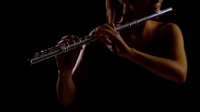Teenage girl playing flute