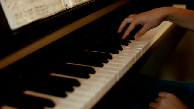 teenage girl playing piano - piano stock videos & royalty-free footage