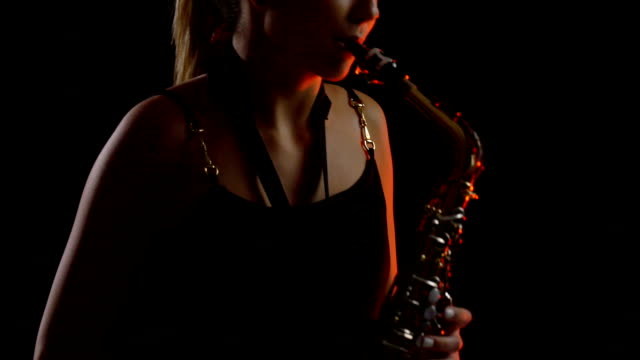 teenage girl playing saxophone - saxophone stock videos and b-roll footage