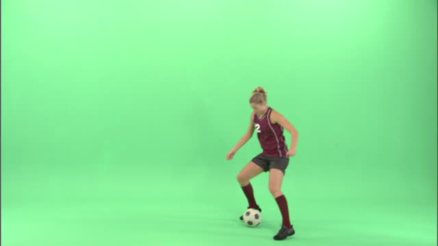 ws, teenage girl (16-17) playing soccer in studio - soccer player stock videos & royalty-free footage