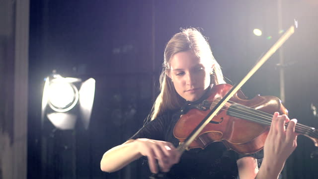 teenage girl playing violin in concert - classical stock videos & royalty-free footage