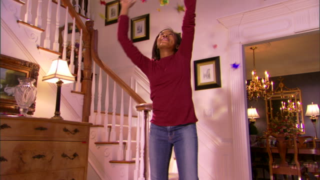teenage girl playing with confetti - one teenage girl only stock videos & royalty-free footage