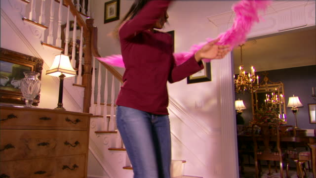 Teenage girl playing with feather boa