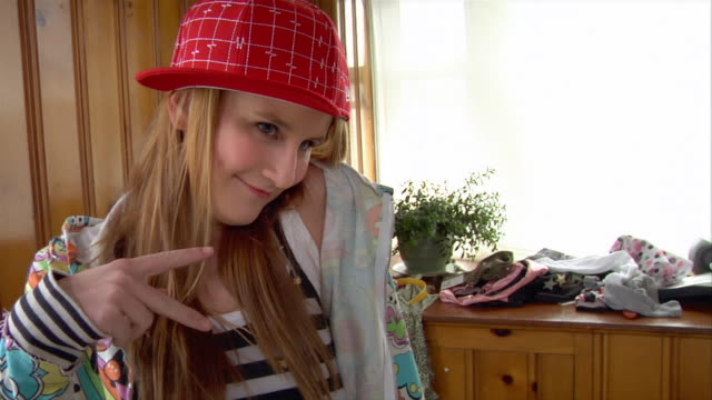 ms teenage girl posing for photo in bedroom with sideways baseball cap/ pan girl taking photo with digital camera - baseball cap stock videos & royalty-free footage