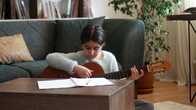 teenage girl practicing guitar - singing stock videos & royalty-free footage