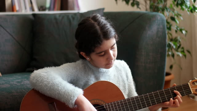 teenage girl practicing guitar - musical instrument string stock videos & royalty-free footage