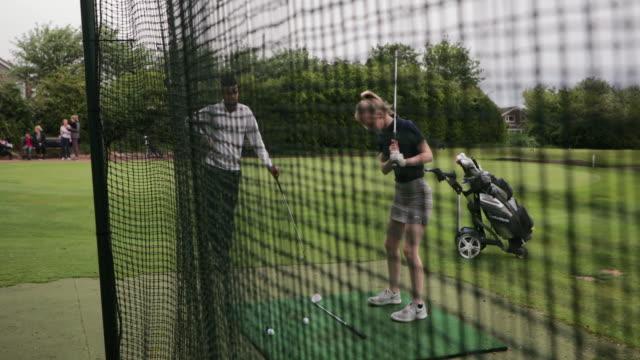 teenage girl practicing her swing - driving range stock videos & royalty-free footage