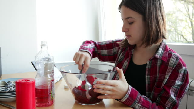 teenage girl preparing beetroot salad at the dining table - salad oil stock videos & royalty-free footage