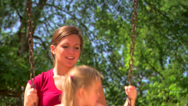 teenage girl pushing girl on a swing - see other clips from this shoot 1428 stock videos & royalty-free footage