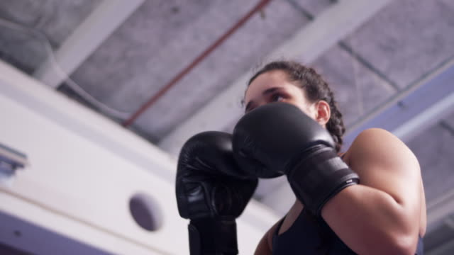 vídeos y material grabado en eventos de stock de teenage girl pushing in boxing ring, exercising with coach - boxeo deporte