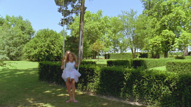 ms, cu, teenage girl (16-17) pushing sister (6-7) on swing in garden, saint ferme, gironde, france - little girls bare feet stock videos and b-roll footage