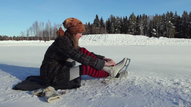 ms teenage girl (14-15) putting ice skates on, sitting on ice / gavle, gastrikland, sweden - leg warmers stock videos & royalty-free footage